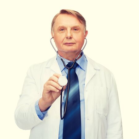 medicare: healthcare and medicine concept - smiling standing doctor or professor with stethoscope
