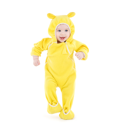 rompers: people, children, achievement and happiness concept - happy baby in yellow suit making first steps