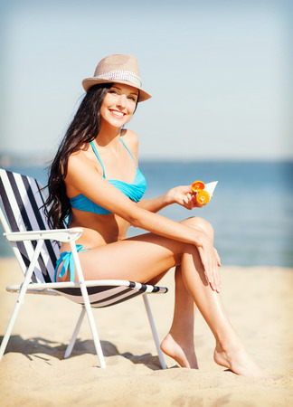 lotions: summer holidays and vacation - girl putting sun protection cream on the beach chair