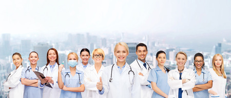 healthcare team: medicine and healthcare concept - team or group of doctors and nurses showing thumbs up Stock Photo