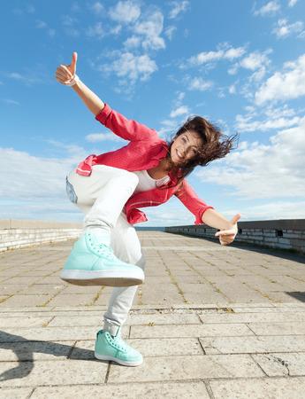 sport, dancing and urban culture concept - beautiful dancing girl in movement Фото со стока - 38662885