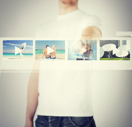 digi: technology, internet and networking concept - man pressing button on virtual screen Stock Photo