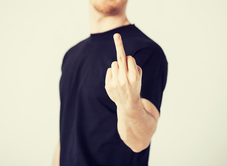 middle finger: close up of man showing middle finger Stock Photo