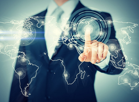 virtual technology: business, technology, internet and networking concept - businessman pressing button with contact on virtual screens
