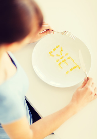 meds: sport, healthcare and diet concept - woman with plate and meds Stock Photo