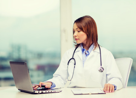 new medicine: medicine and healthcare concept - busy doctor with laptop computer