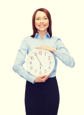 timezone: business and time concept - attractive businesswoman with wall clock