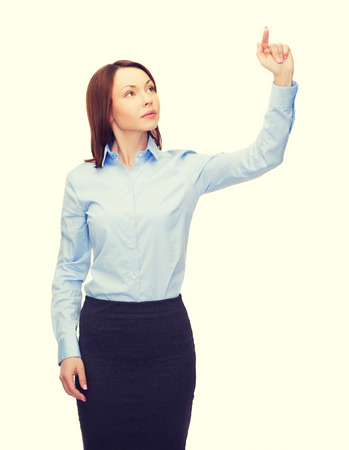 projection screen: business and future technology concept - calm businesswoman working with virtual screen Stock Photo