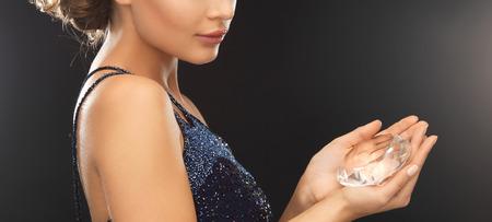 beautiful woman in evening dress with big diamond