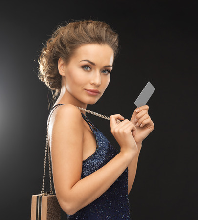 beautiful woman in evening dress with vip card Stock Photo