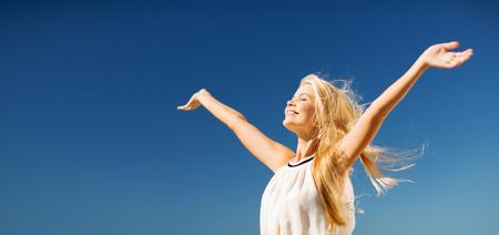lifestyle concept - beautiful happy woman enjoying summer outdoors Stock Photo