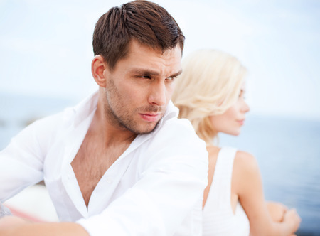 relationship problem: summer holidays, dating and relationships concept - stressed man with woman outside