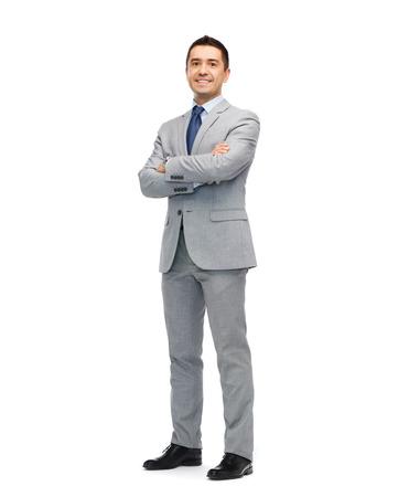 ビジネス、人およびオフィス コンセプト - スーツに幸せの笑みを浮かべて実業家 写真素材