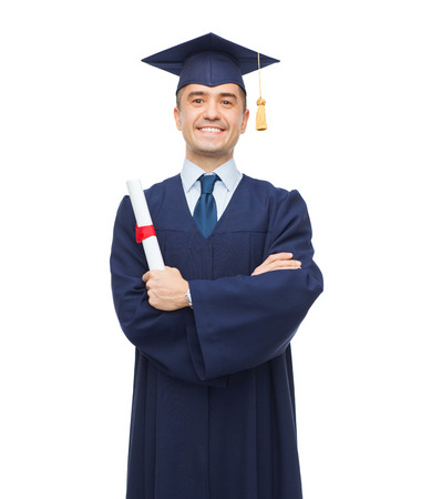 university graduation: education, graduation and people concept - smiling adult student in mortarboard with diploma Stock Photo
