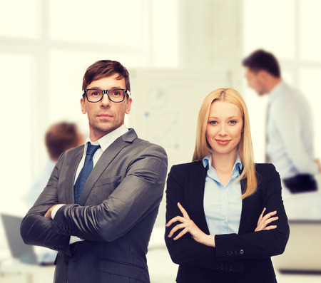 buisness: office, buisness, teamwork concept - businessman and businesswoman in the front of team