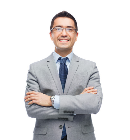 executive: business, people, vision and office concept - happy smiling businessman in eyeglasses and suit Stock Photo