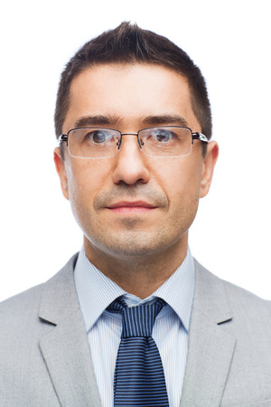 latin man: business, people, vision and office concept - happy smiling businessman in eyeglasses and suit Stock Photo