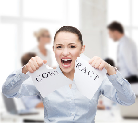 business, documents, people, legal and real estate concept - serious businesswoman tearing contract Stock Photo