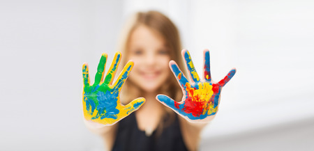 pre teen girls: education, school, art and painitng concept - little student girl showing painted hands