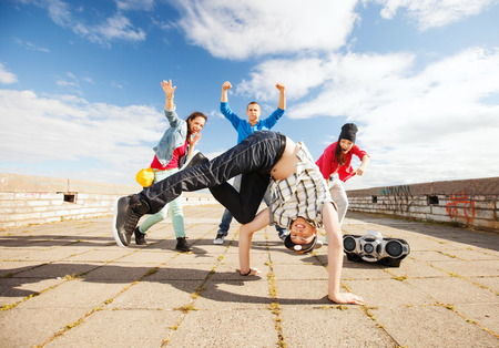 urban culture: sport, dancing and urban culture concept - group of teenagers dancing