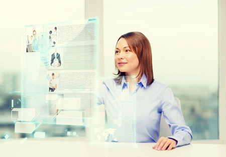 business, education and technology concept - smiling woman pointing to news on virtual screen Stock Photo