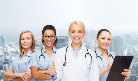 healthcare and medicine: medicine and healthcare concept - team or group of female doctors and nurses