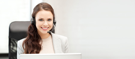 receptionists: office and technology concept - picture of helpline operator with laptop computer