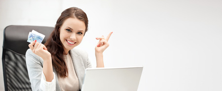 financial cash: online banking concept - picture of happy woman with laptop computer and euro cash money Stock Photo