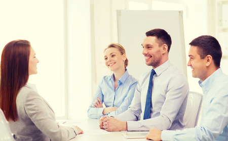 committee: business, career and office concept - smiling businesswoman at job interview in office