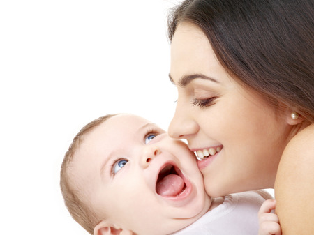hugs and kisses: family and happy people concept - mother kissing her baby Stock Photo