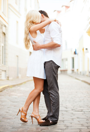 romantic kiss: summer holidays and dating concept - couple in the city
