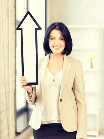 large woman: picture of attractive businesswoman with direction arrow sign