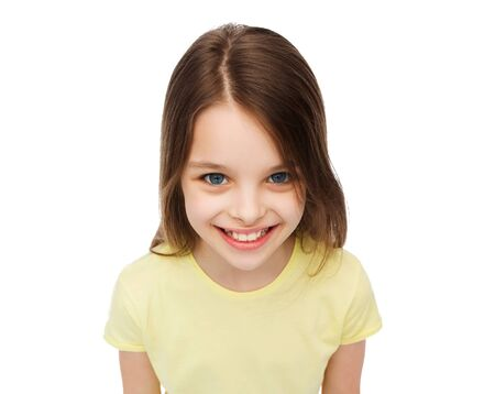 pre teen girls: happiness and people concept - smiling little girl over white background