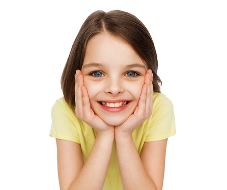 pre adolescence: happiness and people concept - smiling little girl holding head over white background