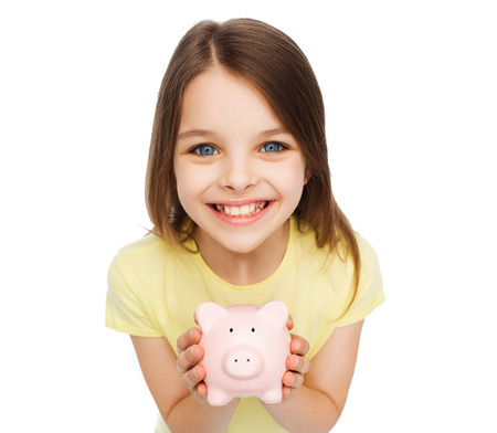 finances, childhood, saving and people concept - beautiful little girl with piggy bank