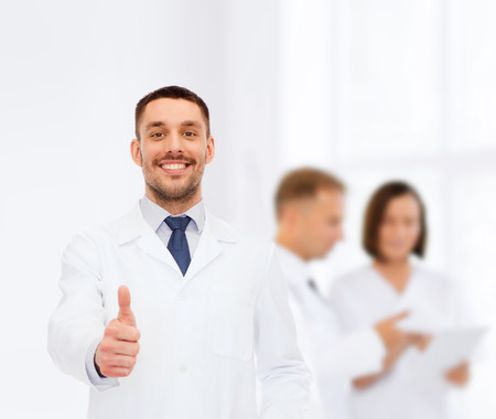 medicare: healthcare, profession and medicine concept - smiling male doctor showing thumbs up over white background Stock Photo