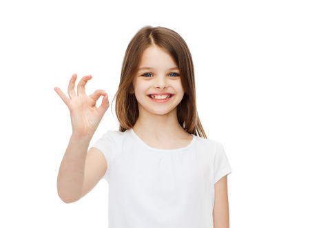 pre teens: happy people and gesture concept - smiling little girl in blank white t-shirt showing ok gesture