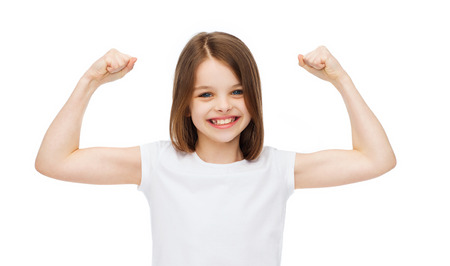 strength, health, sport, fitness concept - smiling teenage girl in blank white t-shirt showing muscles
