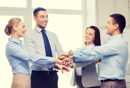 success, business, office and winning concept - happy business team celebrating victory in office photo