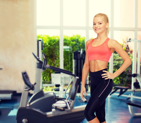 stamina: fitness, sport and diet concept - beautiful athletic woman in sportswear