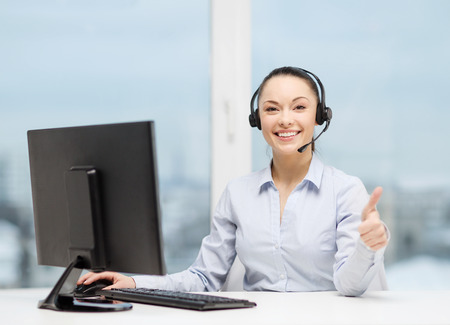 helpline: business, communication and call center concept - friendly female helpline operator with headphones showing thumbs up