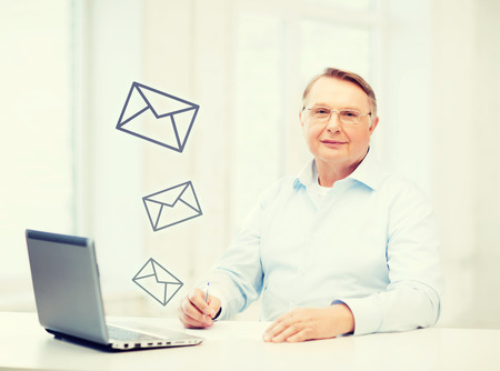 tax office: business, tax, office, school and education concept - old man in eyeglasses filling a form at home Stock Photo