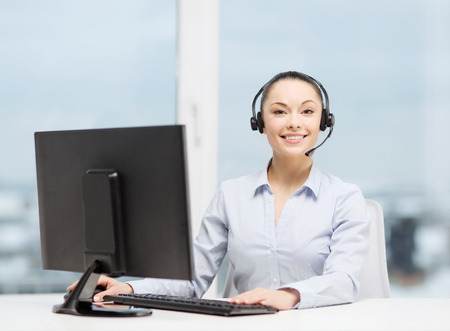 computer operator: business, communication and call center concept - friendly female helpline operator with headphones