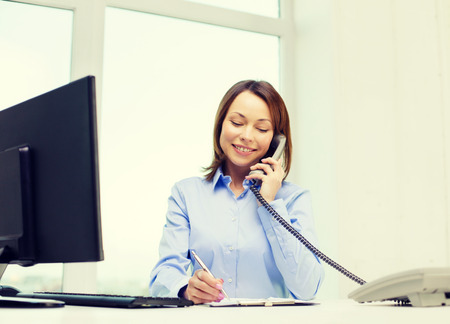 office notes: business, communication and education concept - smiling businesswoman with laptop, documents and telephone
