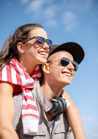 summer holidays, relationships and teenage concept - smiling teenagers in sunglasses having fun outside 版權商用圖片 - 38939266