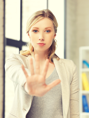 restrain: picture of young woman making stop gesture Stock Photo