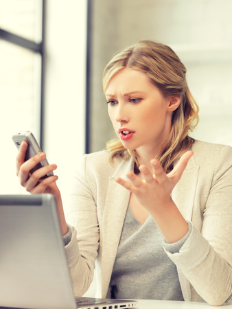 stressed business woman: bright picture of businesswoman with cell phone