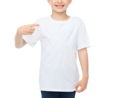 t-shirt design and advertisement concept - smiling little boy in blank white t-shirt pointing at herself Archivio Fotografico