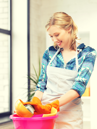 dish washing: picture of beautiful housewife washing dish at the kitchen ..