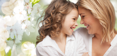 pretty preteen: people, family, love and harmony concept - happy mother and daughter cuddling over green summer garden background